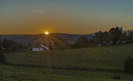 Zbytiny village in sunset time in autumn evening in Sumava national park Reklamní fotografie