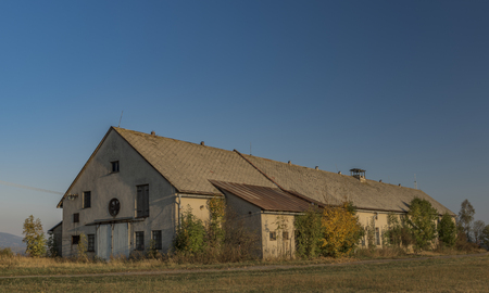 Cowshed in autumn color evening in Roprachtice village with blue sky Reklamní fotografie