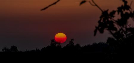 Color dark red orange sunset in Krkonose national park in autumn evening Reklamní fotografie