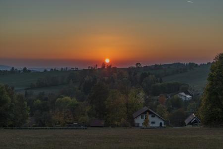 Color dark red orange sunset in Krkonose national park in autumn evening in Roprachtice village Reklamní fotografie