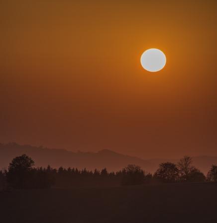 Color dark red orange sunset in Krkonose national park in autumn evening 版權商用圖片