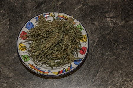 Cooking of marijuana green butter in hot water in kitchen
