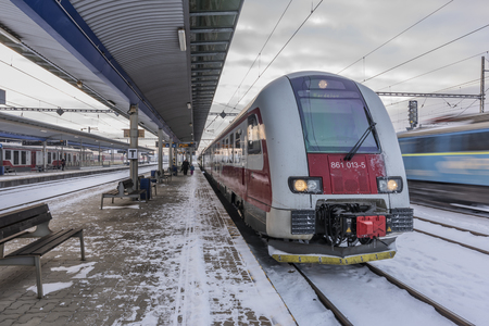 Presov station in winter snow cloudy morning with trains and platforms
