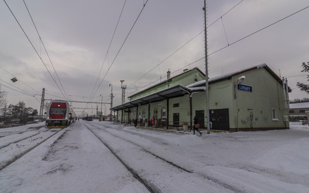 Lipany station in winter snow cloudy morning with trains and platforms