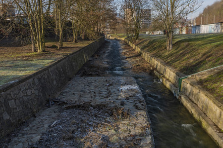 Klissky creek with walls and dam in Usti nad Labem city in winter day Reklamní fotografie
