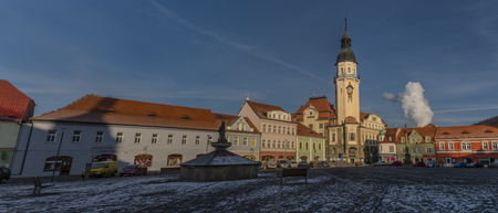 Sunny cold winter morning on main old square in Bilina town in north Bohemia Reklamní fotografie