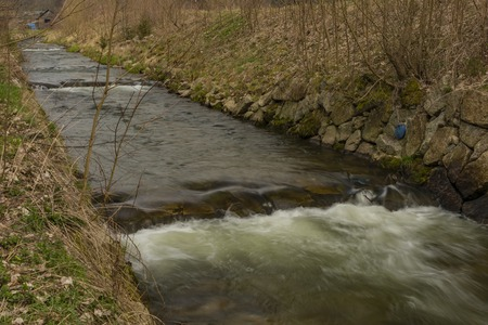 Svatava river in Kraslice town in Krusne mountains in spring cloudy day