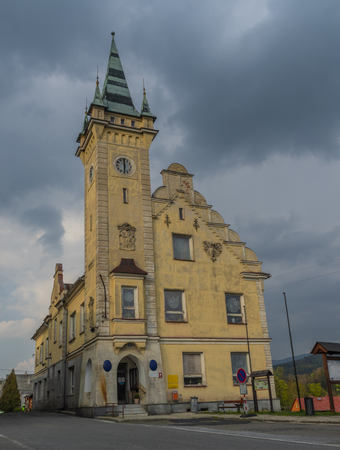 City hall in Branna town in spring cloudy dark day in Jeseniky mountains Imagens