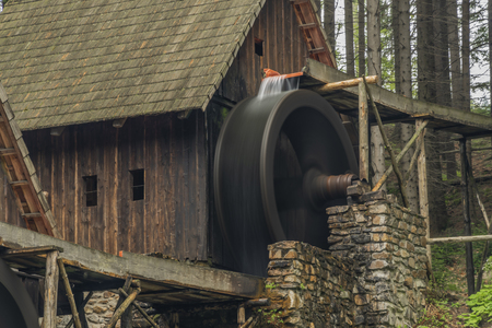 Wooden old mill in forest in valley near Zlate Hory town in north Moravia