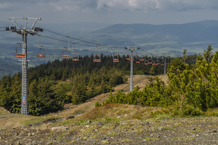 Cable car from Ramzova village to Serak hill in spring cloudy morning