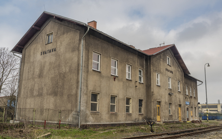 Svatava station with big building and platform in spring cloudy day