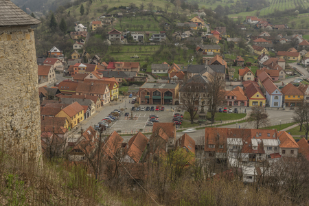 View from Brumov castle for Brumov town in spring cloudy day in Moravia Standard-Bild
