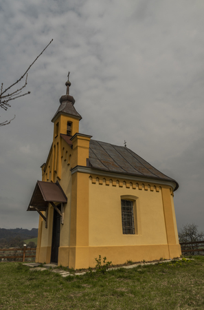 Chapel on hill and meadows over Brumov town in Moravia Reklamní fotografie