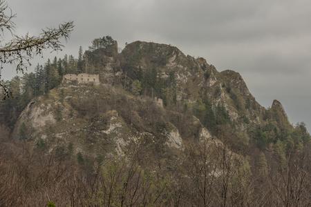 Ruins of castle Vrsatec in spring dark cloudy day in west Slovakia Reklamní fotografie