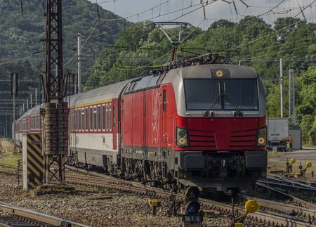 Red slovakia train in Kysak station in east Slovakia in summer morning