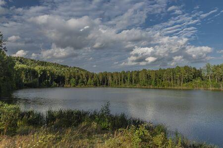 God blessing pond in Kynsperk nad Ohri town in west Bohemia in summer morning