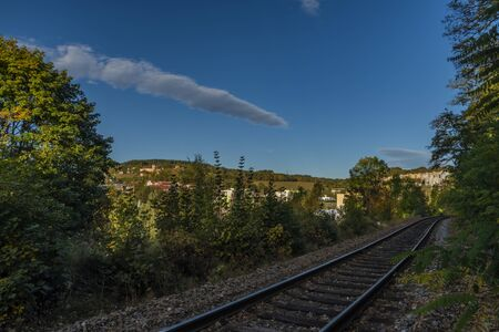 Vimperk town with castle and railway near buildings in autumn sunny color morning