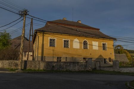 Old color building with blue sky in Besiny village in autumn color evening Stok Fotoğraf