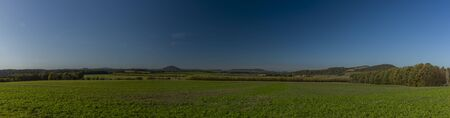 Panorama of green nice meadow with blue sky in Duba town area in central Bohemia