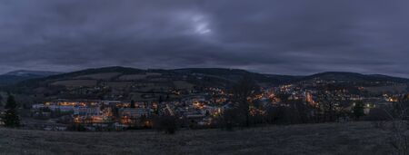 View over Vimperk town in winter dark cold evening in centre of national park Sumava