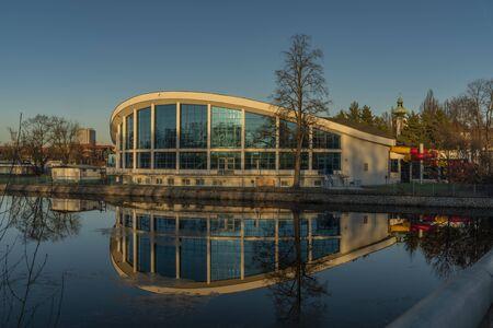 Swimming hall in Ceske Budejovice near Vltava river in sunny winter color evening Stock Photo