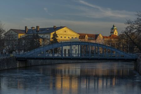 Centre of Ceske Budejovice city with old houses and towers and rivers in sunny winter evening Stock Photo