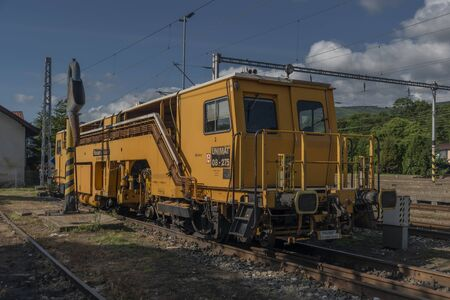 Working yellow train in Kysak station in summer nice sunny color day