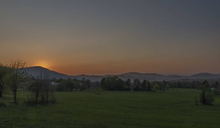 Color sunset with fresh meadows and Javornik hill near Trojanovice village