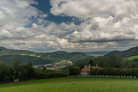 View for valley near Semmering village in Austria mountains in summer cloudy day
