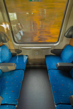 Blue seat compartment in fast express train in Czech republic from Linz to Prague