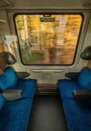 Blue seat compartment in fast express train in Czech republic from Linz to Prague Reklamní fotografie