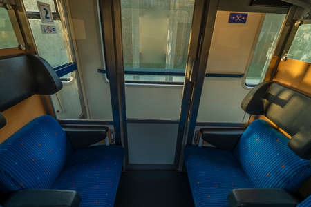 Blue seat compartment in fast expres train in Czech republic from Linz to Prague