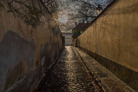 Small old street with stone walls in Novy Svet part of capital Prague in autumn sunny afternoon