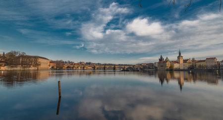 Prague from island on river Vltava near old bridges and towers in autumn sunny color morning Reklamní fotografie