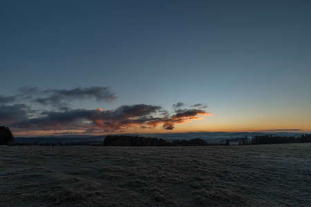 Rybnik village with pasture land in frosty color morning before sunrise in south Bohemia
