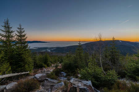 Sunrise on Plechy hill in winter sunny cold morning in Sumava national park