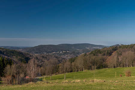 View over  Polubny village in Jizera mountains in green spring sunny color day 免版税图像