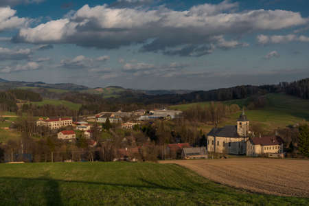 View for Roprachtice village with old church in spring nice sunny color evening