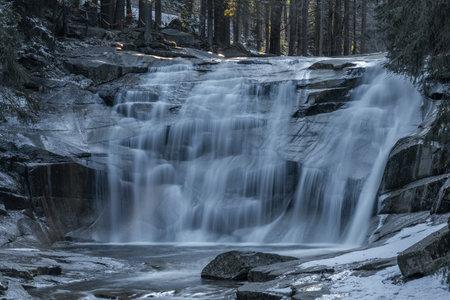 Cold spring morning with Mumlavske waterfalls near Harrachov town in Krkonose national park