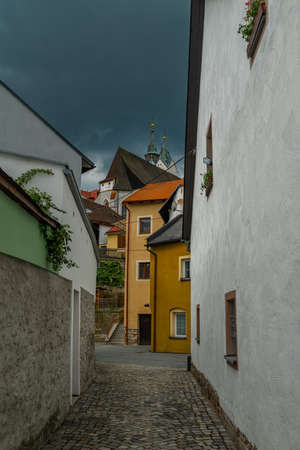 Old historic houses in Vimperk town in spring color fresh rainy day