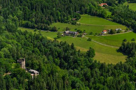 Schockl hill and Ehrenfels castle near Sankt Radegund town in summer color fresh morning 写真素材