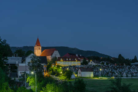 NIght near church with cemetery in Semriach village in south Austria in cold summer 写真素材