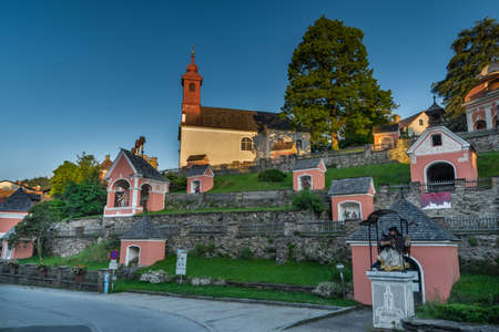 Kalvarienbergkirche church with many of chapels on small hill in summer color morning