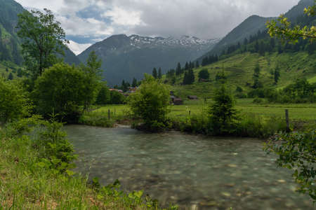 Valley with color small river in Austria Alps mountains near Kree village Reklamní fotografie