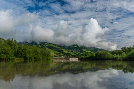 Dam on big Salzach river in Sankt Johann im Pongau in Austria summer mountains