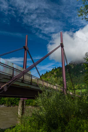 Big bridge over Salzach river in Sankt Johann im Pongau in Austria summer mountains