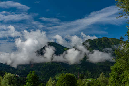 Cloudy mountains in Austria fresh summer color morning