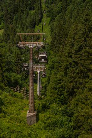 Big cable car poles in Austria green summer hills