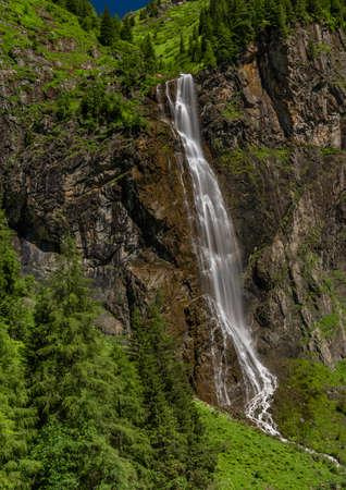 Schleierfall waterfall near Sportgastein place between big color summer mountains