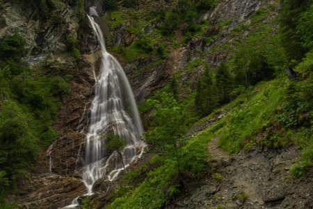 Kreealm waterfall in Austria Alps mountains on big wall near Kree village